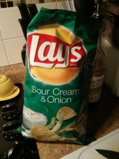 these chips are not an ingredient. they are, however, the suggested snack while making the soup.