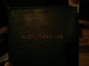 i know it's dark, but i promise it says putters patio and grill.